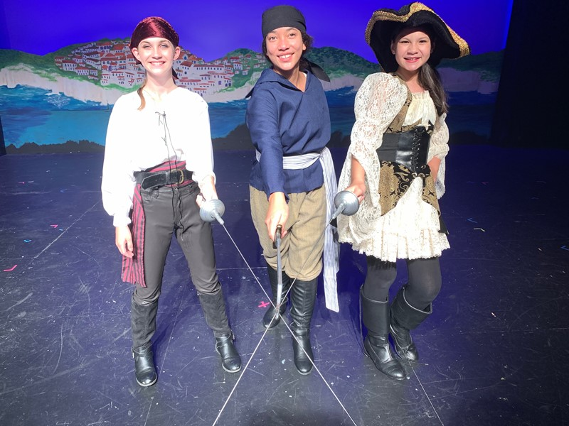 The Pirate King (Lindsay Whiteford), Frederic (Ahlani Gentles) and Ruth (Ella Del Favero) in Pirates of Penzance, junior