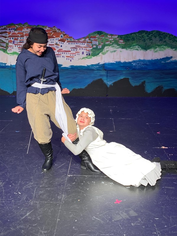 Frederic (Ahlani Gentles), is persued by Ruth (Ella Del Favero) in Pirates of Penzance, junior