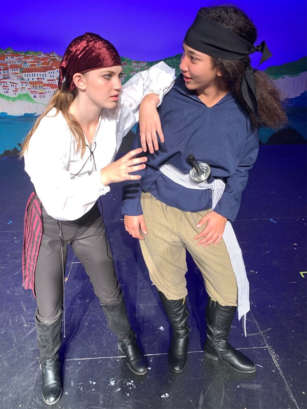 The Pirate King (Lindsay Whiteford), tells Frederic (Ahlani Gentles) the ways of being a Pirate